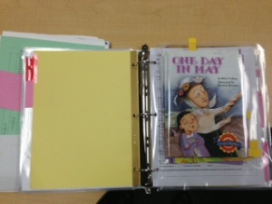 Binder with a pocket for books to read with groups.